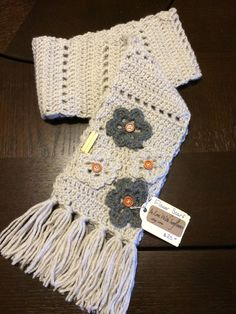 A personal favorite from my Etsy shop https://www.etsy.com/listing/174857236/crochet-scarf-with-flower-accents-scarf