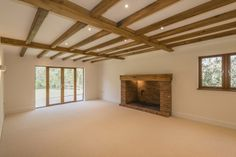 Timber beams and fireplace