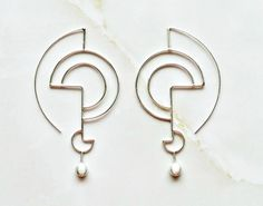 http://sosuperawesome.com/post/145782001097/minimalist-geometric-jewelry-by-theheavenly-on
