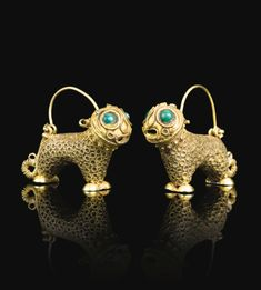A pair of lion-form gold earrings, Persia, 12th century | lot | Sotheby's