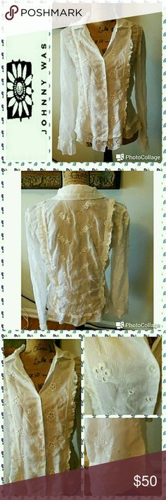"""Johnny Was white ruffled embroidered blouse In excellent condition.  Johnny Was top. White cotton button down front with clear buttons.  Vertical ruffle down front and back. Embroidery detail throughout.  Ruffle cuffs. Shirt tail hem.  Measurements are length 23"""", sleeves 25"""", bust 36"""". Johnny Was Tops Button Down Shirts"""