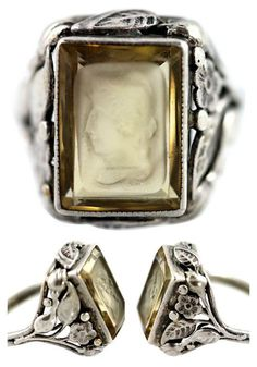 Antique Art Nouveau sterling silver ring set with a hand-carved genuine topaz. Carving is intaglio. Stone has been tested. Size: 5.5; weight, 5.1 grams. Era: An