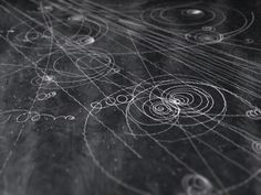 A cloud chamber is an early form of the particle accelerator that uses magnetic fields to exert a force on subatomic particles. Beautiful tracks are created as the particles interact with a gas, usually carbon dioxide, used as a detector. These tracks are from the Cavendish Laboratory
