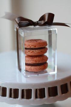 Dark Valrhona Chocolate Orange French Macarons inside a Crystal Clear Wedding Favor Box, tied with Mocha Satin Ribbon