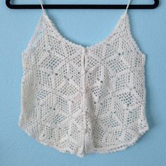 White crochet tank top Never been worn! Its in PERFECT condition. Not from Free people Free People Tops