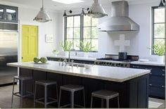 Subtle differences in shades of gray provide surprising palette-focused interest in this expansive kitchen. The neutral kitchen paint color offers just… Kitchens Without Upper Cabinets, Kitchen Cabinets, Kitchen Ideas No Upper Cabinets, Kitchen Without Wall Cabinets, Granite Kitchen, Kitchen Island, Interior Design Kitchen, Kitchen Decor, Kitchen Paint Colors