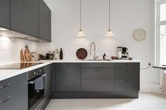 scandinavian interior_charcoal gray kitchen cabinets