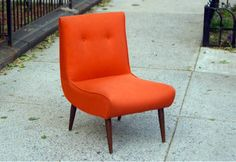 bright orange chair is a must