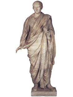 Augustus in a toga, Roman statue (marble), head and body do not belong, 1st century AD (head) 2nd century AD (body), (Musée du Louvre, Paris).