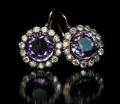 Antique Imperial Era Russian Amethyst and Diamond Cluster Earrings, made in Moscow between 1899 and 1908. 56 zolotniks gold (14K - 583), central round amethysts surrounded by Old European cut diamonds
