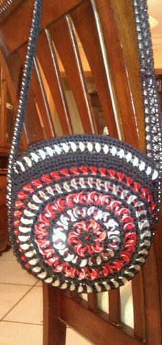 Crochet bag made with soda taps.