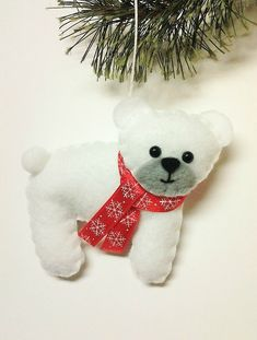 This is a felt polar bear Christmas ornament.  For an additional fee I can personalize this ornament for someone special! The name will be