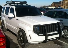 """2010 white jeep liberty with black grill, rims, grill guard and roof rack. """"stormtrooper"""" id like my jeep to look like this one."""