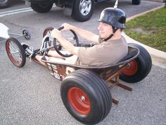 Cool go cart made out of a wheel barrow.