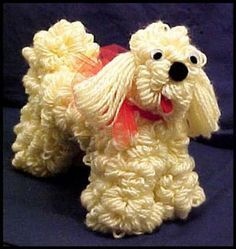Yarn Dog made on wire hanger.  Mamie use to make and sell these. She shared her instructions with me and I made some too as a child.