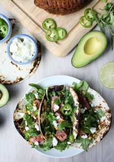 Lime marinated steak tacos with charred corn and goat cheese