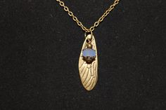 Antique Bronze Wing or Leaf Necklace with Blue by SkygrownJewelry. $18.00 USD, via Etsy.  #nature #jewelry #etsy #handmade