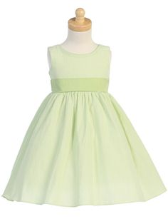 This adorable dress is perfect for those special occasions this spring and summer. Made of light green seersucker, it is reminiscent of times gone by. The sewn in waist band is organza and ties in a gorgeous large bow in the back. Not only will she love wearing this adorable dress, you'll find lots of occasions for her to wear it to. $54.00