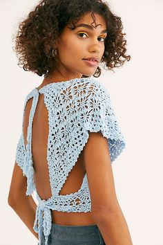 Frill Edge Crochet Crop Top Boho crochet top featured in a cropped silhouette with a plunging V-neckline. * Front button closures * Wide short sleeves * Open back * Adjustable tie at the back waist and neck Crochet Halter Tops, Tops Tejidos A Crochet, Gilet Crochet, Crochet Crop Top, Crochet Blouse, Crochet Stitches, Crochet Bikini, Knit Crochet, Crochet Patterns