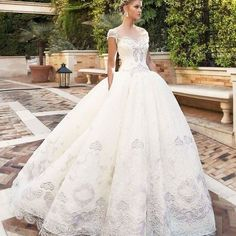 Upstage your look with this enchanting ball gown from @alessandrarinaudo! The flattering lace appliques on the bodice and skirt give this dress an alluring end note. We believe that this look will goes really well with a grand tiara and a chignon hairdo! Can you see yourself walking down the aisle in this? Show some love if you do! Dress @alessandrarinaudo