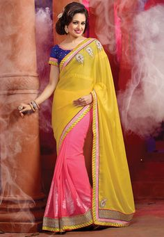 Sway away your onlookers dressed in this yellow and pink georgette half n half saree. The lovely lace and resham work a considerable feature of this saree. Latest Indian Saree, Indian Sarees Online, Silk Sarees Online, Designer Sarees Collection, Saree Collection, Bollywood Dress, Lehenga Saree, Art Silk Sarees, Half Saree