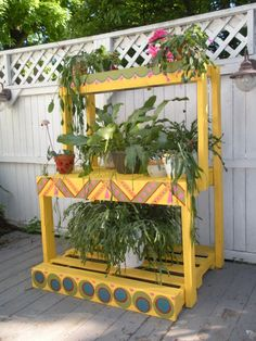 """Pallets and colorful paint for my plants -  55""""h x 43""""w x 16/27/33""""d"""