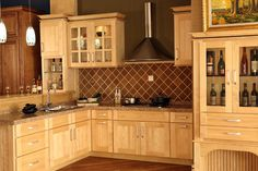maple cabinets white appliances dark floor - Google Search