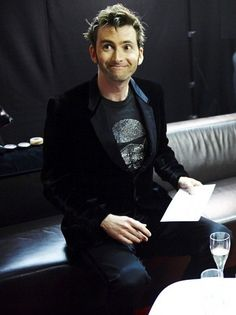 David Tennant. Wearing a bedazzled Stormtrooper t-shirt. And a blazer. With the cutest smile on the planet. The end.