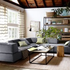 Sofa Tillary Sofa In Home With Curtain And Window Also Nightstand As Well As Decorative Plants And Flower Vase And Carpet With Wooden Table Also Rack Why You Should Choose Tillary Sofa For Your Room