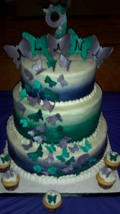 3 Tier Butterfly cake with everything edible, hand made and painted by me.