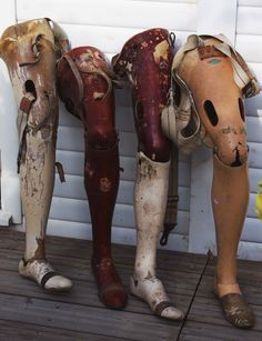 These are fantastic 1920's wooden prosthetic legs – they would make great props or shop display.  There has been some woodworm over the years and some of the paint has deteriorated.