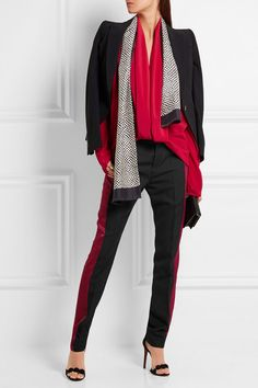 Haider Ackermann Satin-paneled wool-crepe tapered pants $785 Black wool-crepe, claret satin Concealed button, hook and zip fastening at front 100% wool; trim: 79% acetate, 21% rayon Dry clean