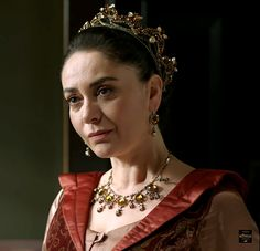 Gulbahar's pale silk dress & rust red overcoat,... - Magnificent Wardrobe