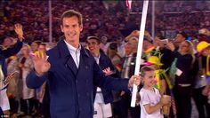 Murray, waved at the crowd as he led the British Olympic team through the stadium at the welcoming of the athletes