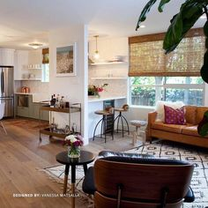 The open design of this mod space feels homey with '70s inspired leather and wood furniture. Find out what your design personality is with our free style quiz at http://ift.tt/1N6UGTP. by laurelandwolf