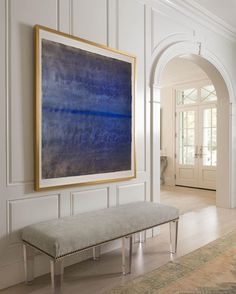 Paneling Detail | oversized framed print \ painting | blue artwork in hallway with bench | modern interior design ideas
