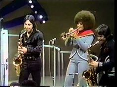 Thank you   /  Sly & the Family Stone  LIVE !  on soul train.  Oh, i wish i could get my hair to grow out like the trumpet players.  Or even Carlos Santana's wife Cindi.