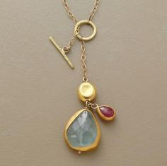 FRONTISPIECE NECKLACE--Nava Zahavi turns the clasp to the front and turns heads in the process. Her aquamarine and ruby are set in hand crimped 24kt gold bezels. 18kt gold bead and toggle
