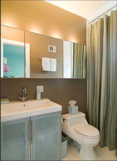 row of mirrored medicine cabinets makes a small bathroom look bigger