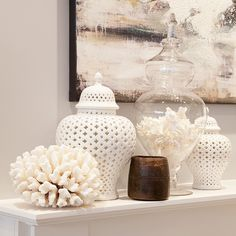 White Temple Jars on the mantle.