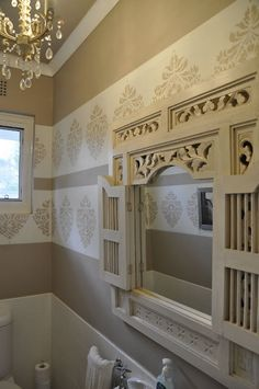 Bathroom Decor - I have that mirror in a dark Indonesian wood, can't believe how fabulous it looks white!