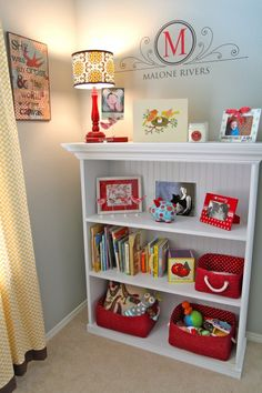 Take an old bookshelf, put wainscoating on the back, and add a piece of molding...paint it the color you prefer and you have a new, updated bookshelf. Love the monogram too!