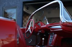 Red interior in a Corvette outside Garage 77 in Los Angeles Red Interiors, Corvette, Garage, Cars, Vehicles, Carport Garage, Corvettes, Autos, Garages
