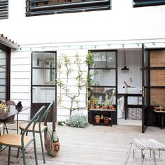 This central decked courtyard – the heart of this beautiful home on France's Île de Ré – leads into the family's laundry room, where simple ...