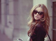 5b2142dc894 Cat eye sunglasses and soft long voluminous hair.