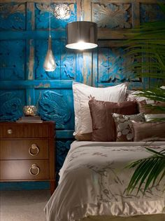 Bex Hale's Design Portfolio - Design Star : Hand-carved, 200-year-old church doors from Mexico create a dramatic headboard and pack a colorful punch in this soothing bedroom.