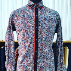 Printed shirt with black placket and red pipin