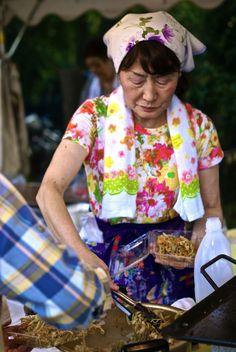 Dishing up some yakisoba at a Japanese festival