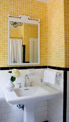 OVERALL: White & yellow vintage bathroom design with white subway tiles, black trim, sink, tapware, Wallpaper design.