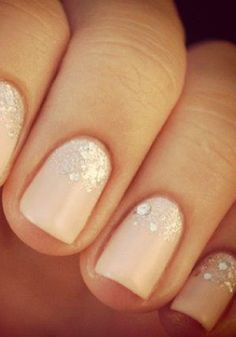 Glittery pink nails.